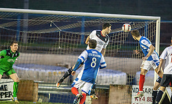 Cowdenbeath's Greg Stewart heads towards goal, but its saved by Falkirk's keeper Michael McGovern.<br /> Cowdenbeath 0 v 2 Falkirk, Scottish Championship game today at Central Park, the home ground of Cowdenbeath Football Club.<br /> © Michael Schofield.