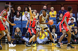 Dec 1, 2018; Morgantown, WV, USA; West Virginia Mountaineers forward Wesley Harris (21) looks to make a move during the first half against the Youngstown State Penguins at WVU Coliseum. Mandatory Credit: Ben Queen-USA TODAY Sports