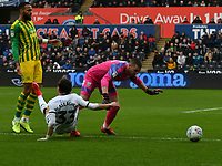 Football - 2019 / 2020 Sky Bet (EFL) Championship - Swansea City vs. West Bromwich Albion<br /> <br /> Conor Gallagher of Swansea City brought down by Sam Johnstone of WBA in a defensive mix up on the edge of the box, at The Liberty Stadium.<br /> <br /> COLORSPORT/WINSTON BYNORTH