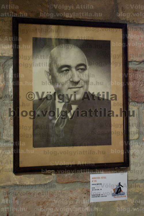 Photo of late leader Matyas Rakosi of socialist Hungary is on display with paintings and sculptures made in the style of socialist realism of Soviet leader Vladimir Ilyich Lenin. Large number of artifacts from Hungary's socialist past found in the basements of different ministries after a change in political power. These communist pictures and sculptures are now being prepared for a charity auction to support those affected by the recent red sludge catastrophe in Hungary. The auction drawing great attention from around the world is to be held on December 6th in Budapest, Hungary. Photos taken during preparations for the auction on November 25, 2010. ATTILA VOLGYI