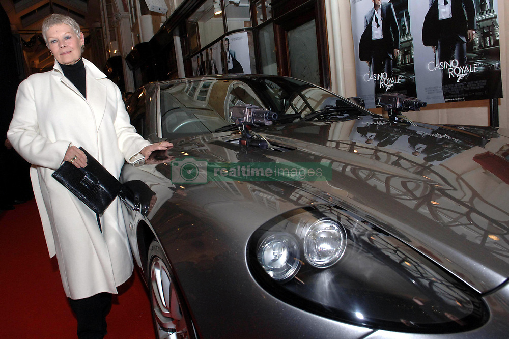 Bond star Dame Judi Dench with a silver Austin Martin Vanquish used in the Bond film Die Another Day at the Burlington Arcade, near Piccadilly tonight where she turned on their Christmas lights.