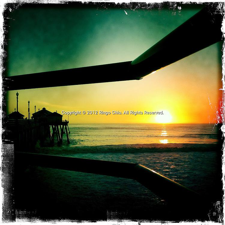 The sunset is seen at the Manhattan Beach Pier in Manhattan Beach, California, USA. (Photo by Ringo Chiu/PHOTOFORMULA.com).