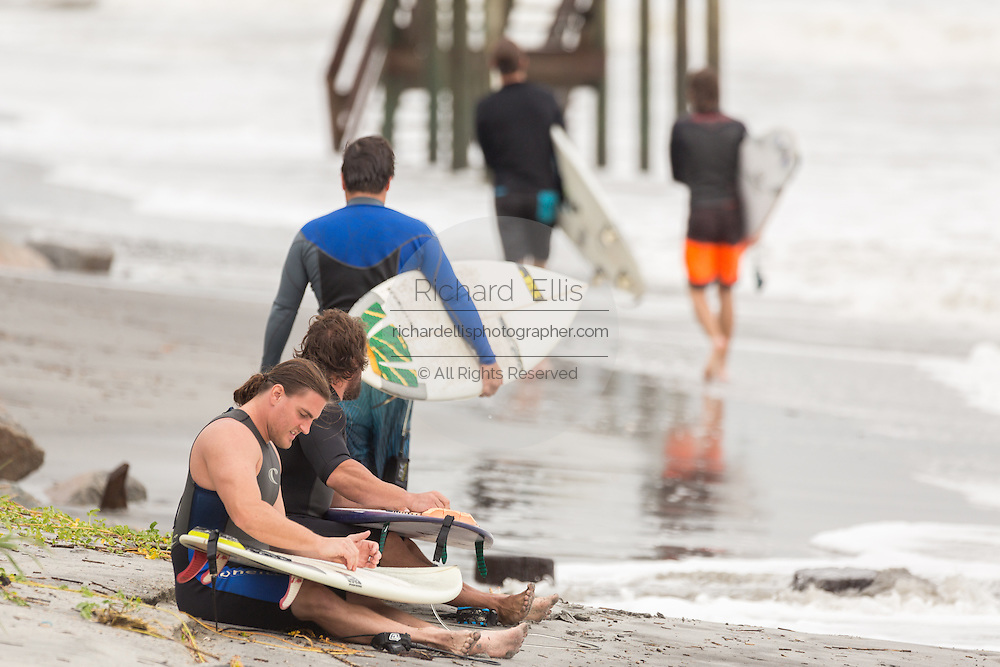 Surfers gather along the Folly Washout as waves churned up as Hurricane Joaquin passes off shore bringing high surf and rip tides to the beaches along the South Carolina coast October 2, 2015 in Folly Beach, SC. Joaquin is expected to avoid the Carolinas but has already caused high surf and flooding.