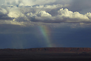 A rainbow forms over Monument Valley on the southern border of Utah with northern Arizona. The valley lies within the range of the Navajo Nation Reservation. The Navajo name for the valley is Tsé Bii' Ndzisgaii - Valley of the Rocks.