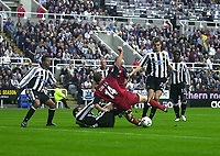 Photo. Glyn Thomas<br />Newcastle United v Bolton Wanderers. <br />Barclaycard Premiership.<br />St James' Park, Newcastle. 20/09/2003.<br />Chaos in the Newcastle penalty area as the defence breaks down and almost allows Kevin Davies to score for Bolton.