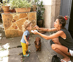 """Elisabetta Canalis releases a photo on Instagram with the following caption: """"Neanche io mangerei se mia madre mi facesse quelle facce . I wouldn't eat either if my mom was making that weird face .( Ettore aspetta paziente che cada qualcosa)"""". Photo Credit: Instagram *** No USA Distribution *** For Editorial Use Only *** Not to be Published in Books or Photo Books ***  Please note: Fees charged by the agency are for the agency's services only, and do not, nor are they intended to, convey to the user any ownership of Copyright or License in the material. The agency does not claim any ownership including but not limited to Copyright or License in the attached material. By publishing this material you expressly agree to indemnify and to hold the agency and its directors, shareholders and employees harmless from any loss, claims, damages, demands, expenses (including legal fees), or any causes of action or allegation against the agency arising out of or connected in any way with publication of the material."""