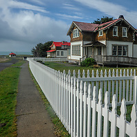 Picket fences border the lighthouse keeper's houses at Point Cabrillo Light Station Mendocino County, California.