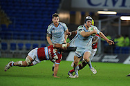 Sam Warburton of Cardiff Blues is tackled by Juan Pablo Orlandi.   Heineken cup, Cardiff Blues v Racing Metro at the Cardiff city stadium in Cardiff, South Wales  on Sunday 22nd  Jan 2012. pic by Andrew Orchard, Andrew Orchard sports photography,