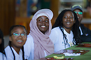 Back at the lodge, Jamilah Wells, 13, center joins others in listing to their peers talk about their favorite part of the day's adventures.