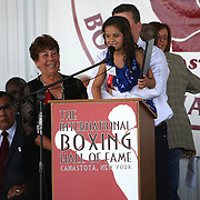 Arturo Gattis's daughter Sofia speaks about her dads induction on stage during the 2013 International Boxing Hall of Fame induction ceremony on Sunday, June 9, 2013 in Canastota, New York.  (AP Photo/Alex Menendez)