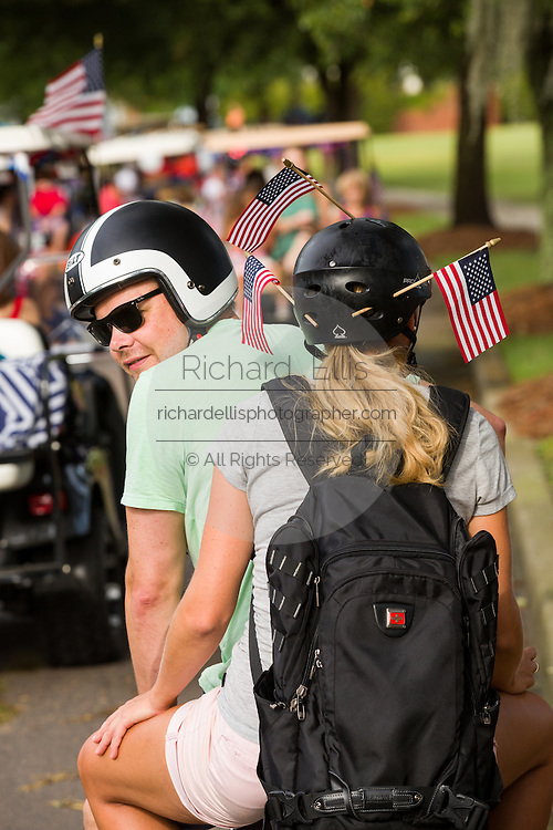 A couple wearing American flags during the Daniel Island Independence Day parade July 3, 2015 in Charleston, South Carolina.