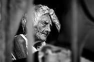 An elderly woman is over-thinking her daily worries.