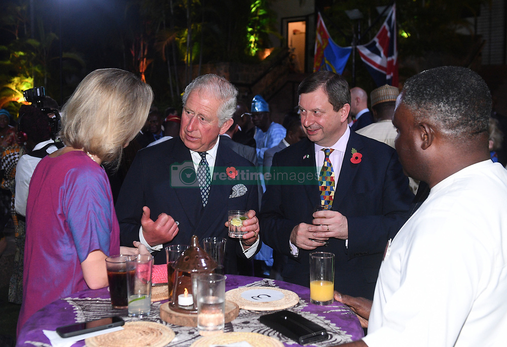 The Prince of Wales with outgoing British High Commissioner Paul Arkwright (second right) at a Commonwealth reception at the high commissioner's residence in Abuja, Nigeria, on day seven of the royal trip to west Africa.