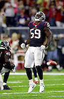 Houston Texans' Whitney Mercilus (59) celebrates after an NFL football game against the Cincinnati Bengals Saturday, Dec. 24, 2016, in Houston. The Texans won 12-10. (AP Photo/Sam Craft)
