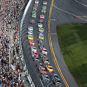 The pack is seen on the first lap of the 57th Annual NASCAR Daytona 500 race at Daytona International Speedway on Sunday, February 22, 2015 in Daytona Beach, Florida.  (AP Photo/Alex Menendez)