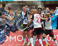 Football - 2020 / 2021 Sky Bet League Two - Crawley Town vs Bolton Wanderers - The People's Pension Stadium<br /> <br /> Antoni Sarcevic and Baptiste of Bolton celebrates with the team after getting Promotion<br /> <br /> Credit : COLORSPORT/ANDRTEW COWIE