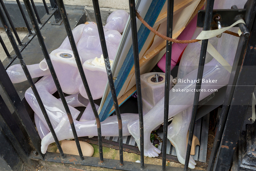 The body parts of a retail mannequin lying trapped behind railings in a West End street, on 7th March 2019, in London, England.