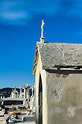 Cross on a decaying mausoleum, St Tropez, France.