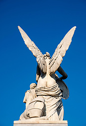 Statue of angel on Schlossbrucke designed by Schinkel at Lustgarten on Museum Island (Museumsinsel) in Mitte, Berlin, Germany