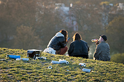 © Licensed to London News Pictures. 18/04/2021. London, UK. Drinks cans strewn across the top of Primrose Hill in North London, despite the park being closed from 10pm last night. A curfew has been put in to place at the park over the weekend  to prevent large gatherings in the evening. Photo credit: Ben Cawthra/LNP