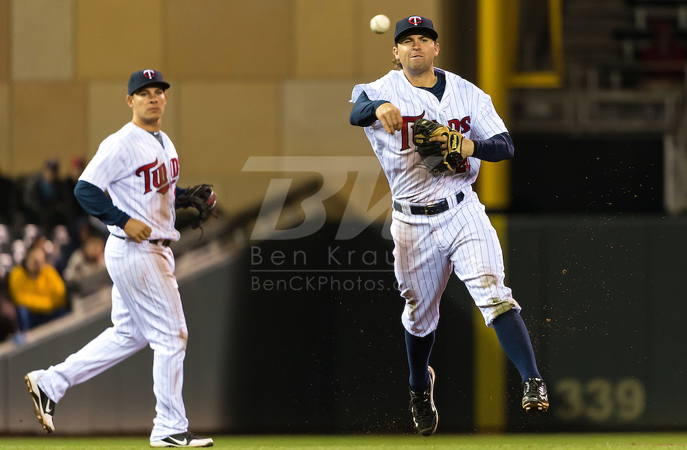 Minnesota Twins shortstop Brian Dozier makes a running throw to 1st base against the Los Angeles Angels on May 8, 2012 at Target Field in Minneapolis, Minnesota.  The Twins defeated the Angels 5 to 0. © 2012 Ben Krause