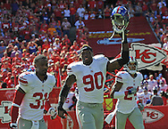 KANSAS CITY, MO - SEPTEMBER 29:  Players Jason Pierre-Paul #90, Aaron Ross #31 and Terrell Thomas #24 of the New York Giants run onto the field before a game against the Kansas City Chiefs on September 29, 2013 at Arrowhead Stadium in Kansas City, Missouri.  (Photo by Peter G. Aiken/Getty Images) *** Local Caption *** Jason Pierre-Paul;Aaron Ross;Terrell Thomas