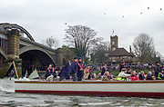 Putney. London.  2004 University Boat Race,  Championships Course, Putney to Mortlake. <br /> the Flotilla following the Oxford and Cambridge, boat race through Barnes Rail Bridge. Barnes/Chiswick.  <br /> <br /> [Mandatory Credit Peter SPURRIER]