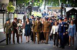 Service men and Women walk up Downing St to meet the The British Prime Minister David Cameron and US President Barack Obama for a barbecue in the gardens of Number 10 Downing Street, London, On day 2 of the Presidents  UK tour, Wednesday May 25,2011. Photo By Andrew Parsons/Parsons Media