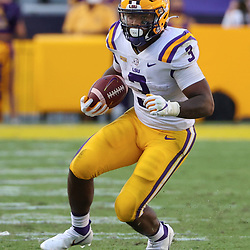 Sep 26, 2020; Baton Rouge, Louisiana, USA; LSU Tigers running back Tyrion Davis-Price (3) runs against the Mississippi State Bulldogs during the second half at Tiger Stadium. Mandatory Credit: Derick E. Hingle-USA TODAY Sports