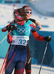 February 18, 2018 - PyeongChang, South Korea - 21st and 22nd place (L-R) ROSIE FRANKOWSKI of USA and NATHALIE VON SIEBENTHAL of Switzerland hug at the finish of Cross-Country Skiing: Ladies' 30km Mass Start Classic at Alpensia Cross-Country Skiing Centre during the 2018 Pyeongchang Winter Olympic Games.(Credit Image: © Scott Mc Kiernan via ZUMA Wire)