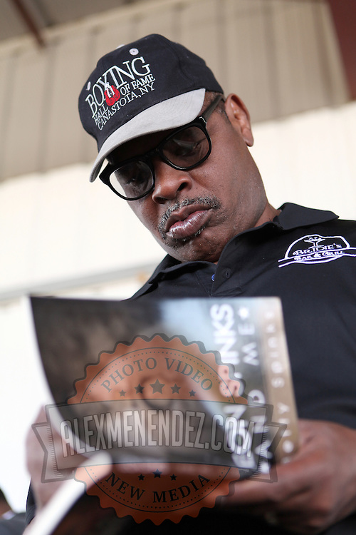 Heavyweight Boxing Champion Leon Spinks signs his book during the 23rd Annual induction weekend opening ceremony at the International Boxing Hall of Fame on Thursday, June 7, 2012 in Canastota, NY. (AP Photo/Alex Menendez)