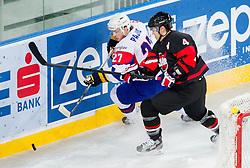 Rok Pajic of Slovenia vs Aaron Keller of Japan during ice-hockey match between Slovenia and Japan at IIHF World Championship DIV. I Group A Slovenia 2012, on April 16, 2012 in Arena Stozice, Ljubljana, Slovenia. (Photo by Vid Ponikvar / Sportida.com)