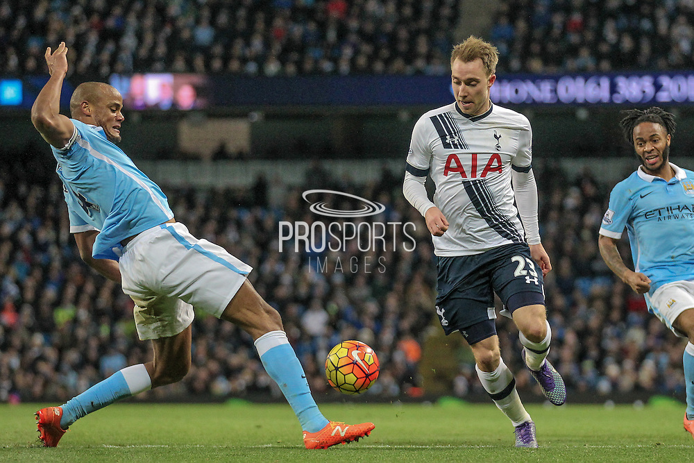 Vincent Kompany (Captain) (Manchester City) clears the ball before Christian Eriksen (Tottenham Hotspur) can get to it during the Barclays Premier League match between Manchester City and Tottenham Hotspur at the Etihad Stadium, Manchester, England on 14 February 2016. Photo by Mark P Doherty.