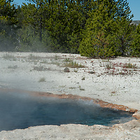 Hot spring water boils in Surprise Pool at Lower Geyser Basin in Wyoming's Yellowstone National Park.