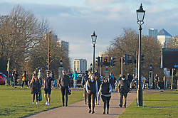 © Licensed to London News Pictures 26/02/2021.        Blackheath, UK.  People get out of their homes from a third national Coronavirus lockdown to enjoy some bright sunny weather on Blackheath Common, London. Photo credit:Grant Falvey/LNP
