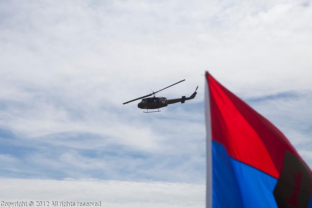 Kokomo Indiana Vietnam Veterans Reunion 2012 American Huey 369 Helicopter flying past flag