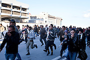 Tunis, Tunisia. January 28th 2011.People run away from Police tear gas....