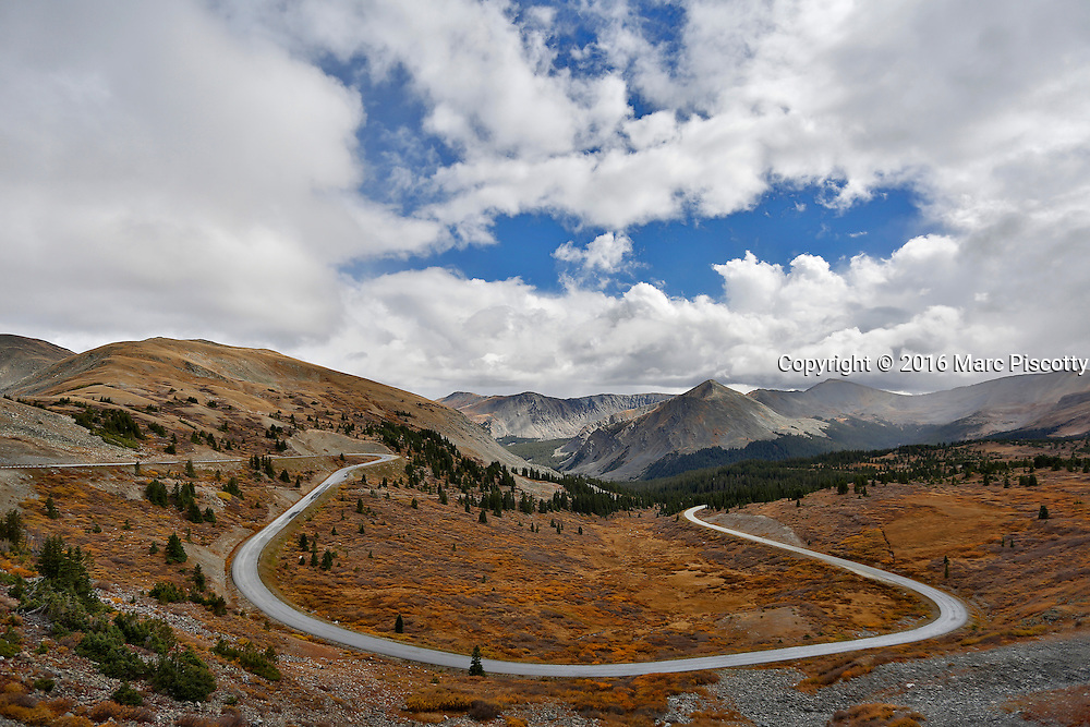 SHOT 9/30/16 2:33:15 PM - Cottonwood Pass (elevation 12,126 feet (3,696 m)) is a high mountain pass in the Rocky Mountains of south-central Colorado, United States. It is located near the border of Gunnison and Chaffee counties in Colorado and is in the Sawatch Range. The area surrounding the pass is mostly forest, with the San Isabel National Forest to the east and the Gunnison National Forest to the west. The Continental Divide is marked at the saddle point of Cottonwood Pass. The pass is closed seasonally due to heavy snowfall, typically from around October until sometime in May. When open, the pass can be accessed from Buena Vista to the east by following Chaffee County Road 306. Near the summit, the road name changes to Gunnison County Road 209 as it continues to the west, passing near Taylor Park Reservoir and continuing down into the town of Almont. The majority of this road is paved, with the exception being the section linking the summit of Cottonwood Pass with Taylor Park Reservoir, which is gravel. When open, the pass is one of the few routes through the Sawatch Range accessible in a standard two-wheel drive passenger vehicle. (Photo by Marc Piscotty / © 2016)