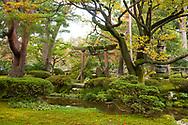 A stone gate and the Hamambashi Bridge in the Kenrokuen Garden, Kanazawa, Ishigawa, Japan
