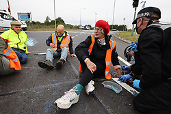 © Licensed to London News Pictures. 20/09/2021. Welwyn Garden City, UK. Protesters from Insulate Britain attempt to blockade the A1M junction 4 near Welwyn Garden City, Hertfordshire. Climate change activists Environmental protest group Insulate Britain have successfully blocked traffic at various points of the M25 on several occasions over the past week. Photo credit: Ben Cawthra/LNP