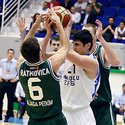 Anadolu Efes's Ersan ILYASOVA (C) during their Turkey Cup Qualifying basketball third match Anadolu Efes between Aliaga Petkim at Aliaga Arena in Izmir, Turkey, Tuesday, October 11, 2011. Photo by TURKPIX