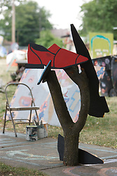 Shoe sculpture by Tyree Guyton.  Heidelberg Project, Detroit, Michigan.  The Heidelberg Project is a grass roots project started by artist Tyree Guyton that uses art to help revitalize the embattled neighborhood.  Each year, over 275,000 people visit the project .  For more information, go to www.heidelberg.org