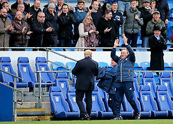 Cardiff City Manager Neil Warnock applauds the fans at full time during the Sky Bet Championship match at The Cardiff City Stadium.