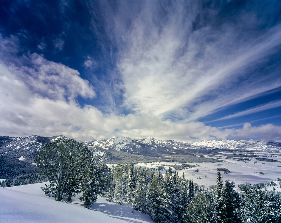 Winter scenic of the Sawtooth Valley from Galena Summit in winter time with dramatic clouds and super blue sky.  Licensing and Limited Edition Prints.