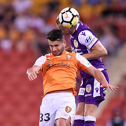 BRISBANE, AUSTRALIA - DECEMBER 21: Petros Skapetis of the Roar and Joe Mills of the Glory compete for the ball during the Round 12 Hyundai A-League match between Brisbane Roar and Perth Glory on December 21, 2017 in Brisbane, Australia. (Photo by Patrick Kearney / Brisbane Roar FC)