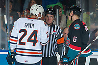 KELOWNA, CANADA - SEPTEMBER 22: Referee Ward Pateman speaks to Luc Smith #24 of the Kamloops Blazers while Kaedan Korczak #6 of the Kelowna Rockets listens in after a fighting penalty call on September 22, 2018 at Prospera Place in Kelowna, British Columbia, Canada.  (Photo by Marissa Baecker/Shoot the Breeze)  *** Local Caption ***