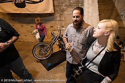 Cristian Sosa of Sosa Metal Works (Las Vegas, NV) and Nicole Fountain during the Friday night opening of the Handbuilt Motorcycle Show. Austin, TX. April 10, 2015.  Photography ©2015 Michael Lichter.