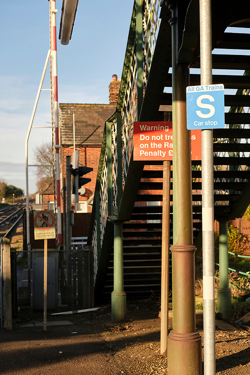 Car Stop sign at the end of the platform at Trimley Station. The footbridge allows people to walk over the line when the level crossing is closed.<br /> <br /> Photo by Jonathan J Fussell, COPYRIGHT 2020