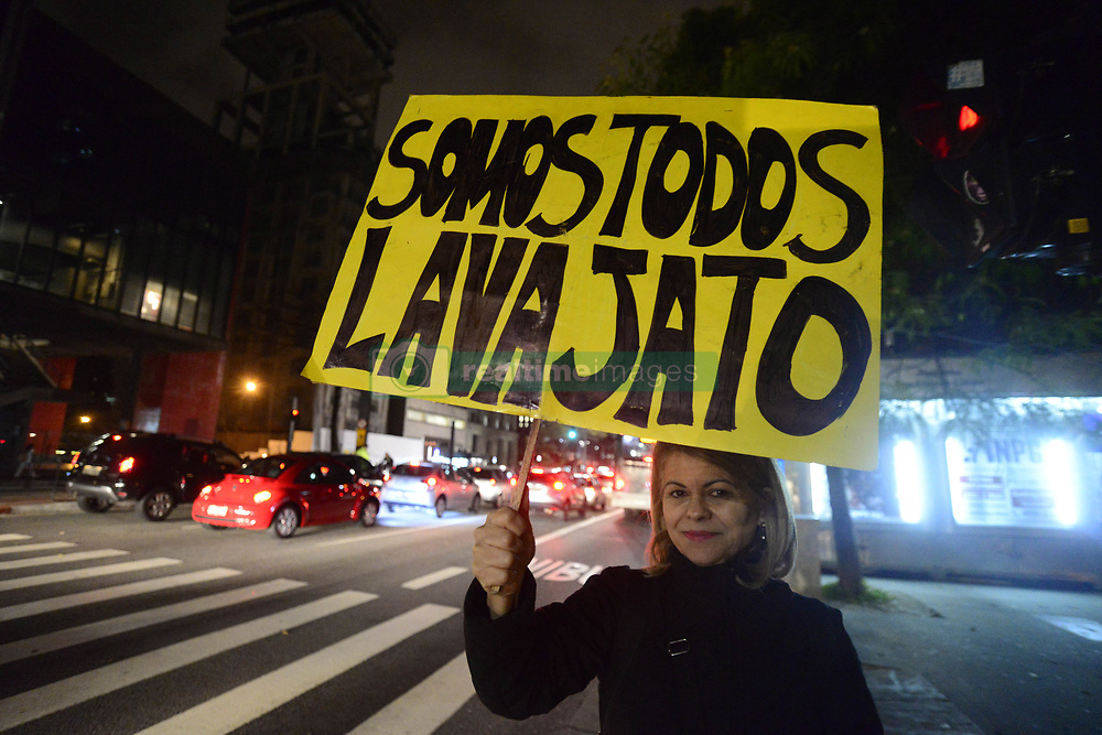 June 9, 2017 - Sao Paulo, Brazil - Protesters protest in SP against decision of TSE on Dilma-Temer plate. The group was bantering critics of the minister Gilmar Mendes, president of the court and responsible for the vote of minerva that defined the trial..A group of protesters protested last night (9), on Avenida Paulista, in São Paulo, against the decision of the Superior Electoral Court that rejected the cassation of the Dilma-Temer plate. Demonstrators carried Brazilian flags and banners criticizing Minister Gilmar Mendes, president of the TSE and responsible for the vote of minerva that defined the outcome of the trial. They also defended the Lava Jato operation and praised Judge Sérgio Moro. (Credit Image: © Cris Faga/NurPhoto via ZUMA Press)