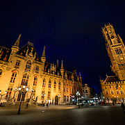 Famous buildings under lights in the Markt (Market Square) in the historic center of Bruges, a UNESCO World Heritage site.